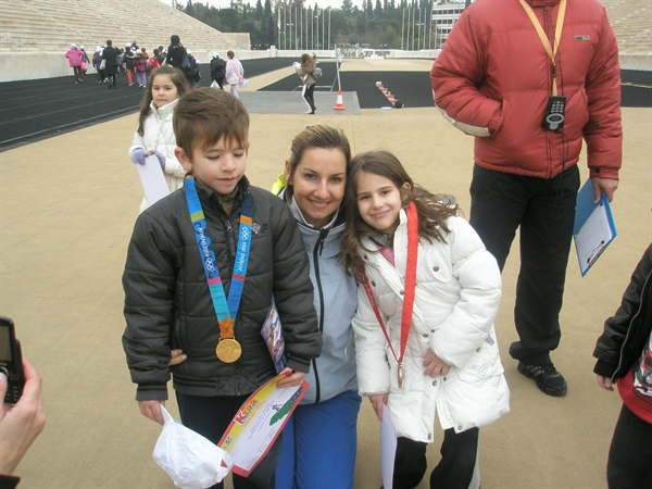Pupils wearing the Olympic Medals